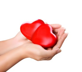two red heart in woman's hand