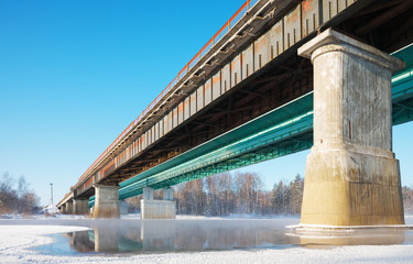 bridge over the river freezes in the cold day