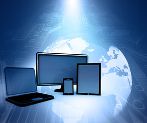 Computer Devices on abstract blue tech background