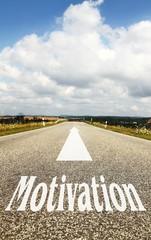 das Wort Motivation auf der Strasse