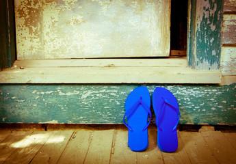 Blue Flip-Flops On The Porch