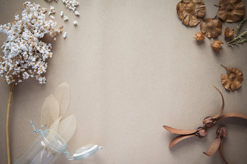 Dried flowers on brown paper background