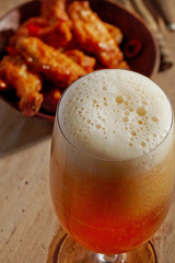 glass of fresh beer and fried chicken wings