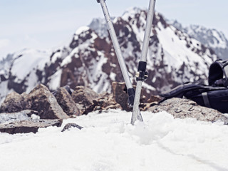 Ski mountain travel poles in the snow of mountain peak