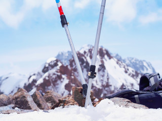 Ski mountain travel poles in the snow of mountain peak