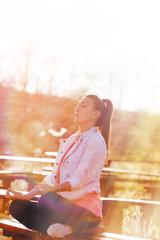 Girl meditating and enjoying the sunlight