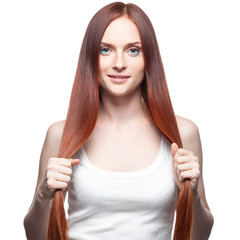 beautiful red haired girl holding her hair