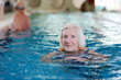 Healthy active senior woman swimming in the pool - 68350032