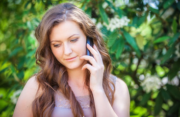 portrait of a smiling beautiful woman talking on the phone