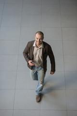 Businessman using smartphone office building lobby
