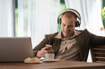 Business man resting cafe listening music