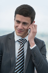 Businessman talking mobile phone