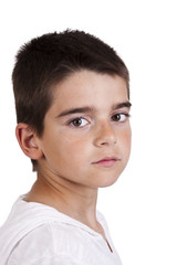 Portrait of boy in closeup over white background