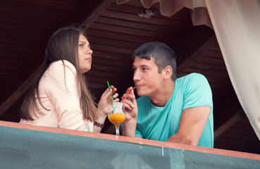 young couple in an open-air cafe