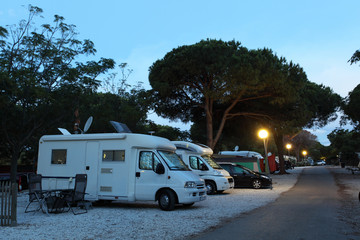 Mobile homes on a camping site at dusk
