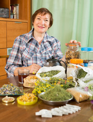 mature woman with medicinal herbs