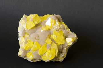 Yellow sulphur on aragonite from Sicily. 14cm across.