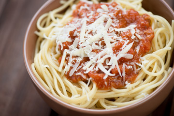 Close-up of spaghetti with bolognese sauce and parmesan cheese