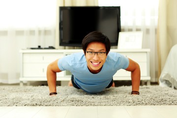 Handsome asian man at home