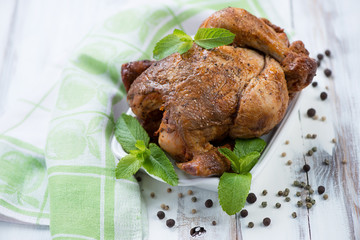 Smoked chicken with various spices, high angle view, studio shot