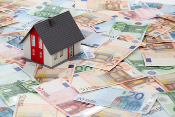 Model house on euro banknotes background