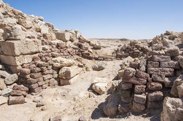 Old roman ruins on desert coastline