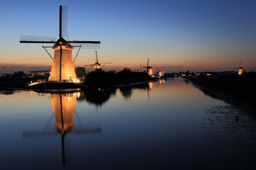 sunset at the windmills of kinderdijk