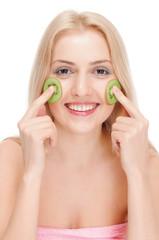 Woman getting fruit cosmetic facial mask