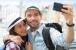 canvas print picture - Young couple on holidays taking selfie