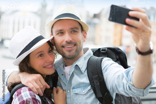 canvas print picture Young couple on holidays taking selfie