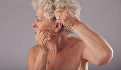 Senior woman wearing a hearing aid
