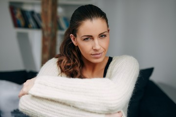 Attractive young lady sitting relaxed at home