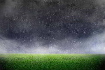 Image of stadium in dark and rain. background green lawn