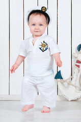 Kid captain, little baby boy dressed as a sea captain