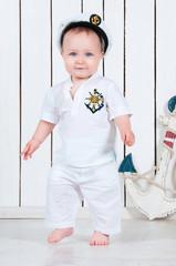 Kid captain, little baby boy dressed as a sea captain