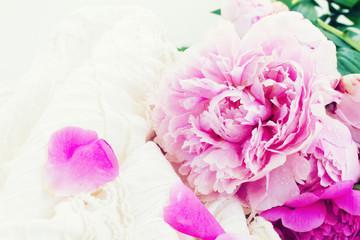 pink peonies and white wedding dress