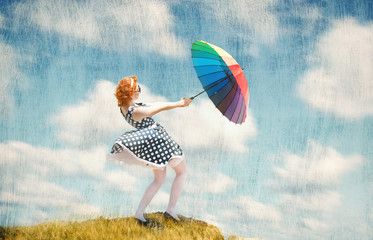 Retro style girl with colorful umbrella in the wind