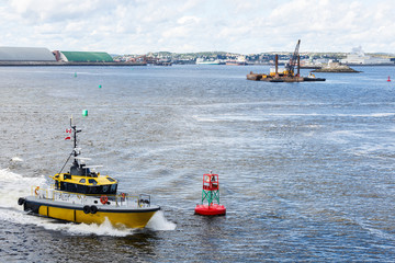Yellow Pilot Boat Rounding Red Channel Marker
