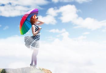 Retro style portrait of a girl with colorful umbrella