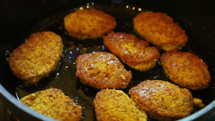 Closeup of frying vegetarian cutlets from lentil