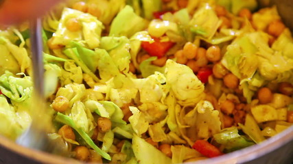 Closeup of mixing vegetable dish sabzi