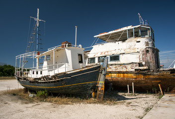 rusting boats at greek dockyard