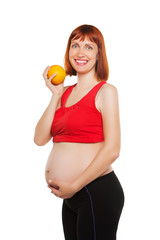 pregnant woman and orange. isolated on a white background