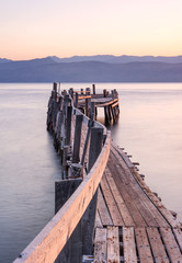 wooden jetty on greek beach