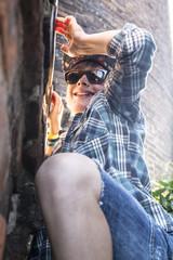 Young boy climbing at the wall
