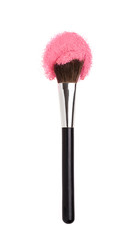 Cosmetics Makeup brushes with pink powder.
