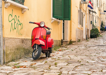 red moped on corfu town street