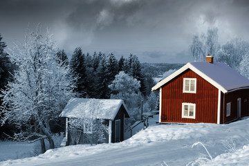 old red cottages in winter time, snowy swedish scenery