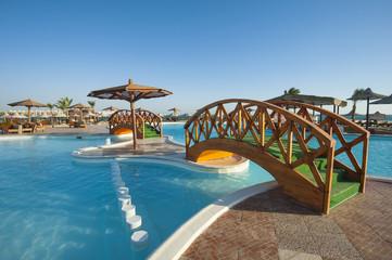 Swimming pool at tropical holiday resort