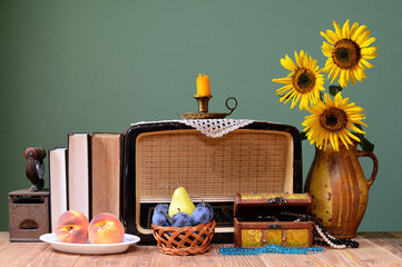 The old radio, sunflower and books
